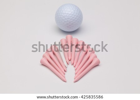 Wooden golf tees and white golf ball on the white background - stock photo