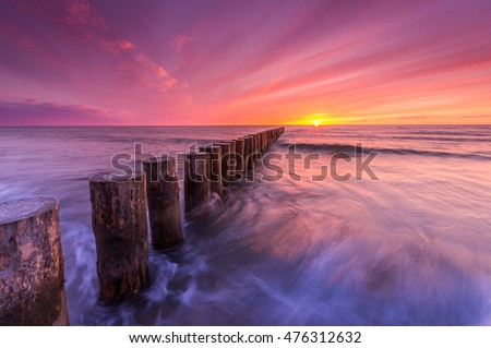 Wooden groyne - Baltic seascape at sunset, Poland