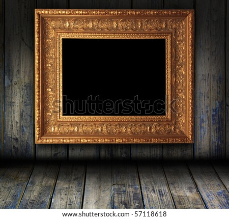 wooden grunge interior with antique picture frame - stock photo