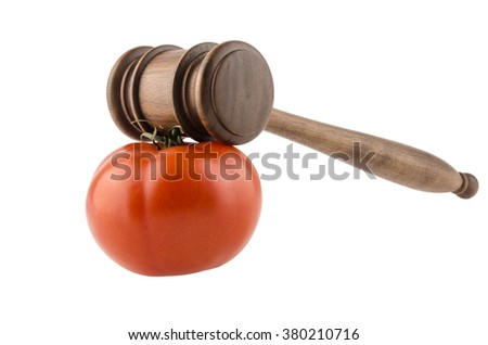 wooden hammer and tomato