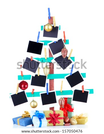 Wooden hand made fir tree with empty photo paper and Christmas decor, isolated on white - stock photo