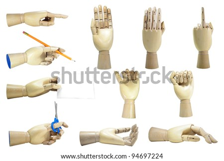 Wooden hands in different positions isolated over white background - stock photo