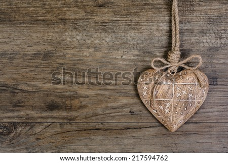 Wooden heart decoration on vintage oak background, space for your text - stock photo