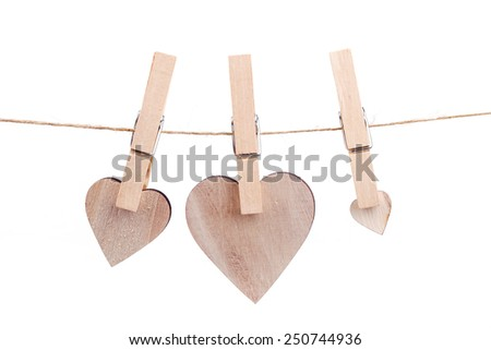 wooden heart hanging on the clothesline, Isolated on white background. Love concept - stock photo