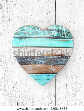 wooden heart on grungy wooden texture - stock photo
