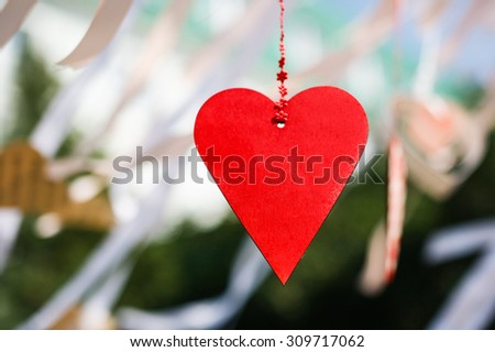 Wooden heart on the handmade celeblation garland - stock photo