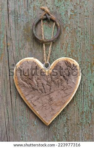wooden heart on tree bark - stock photo