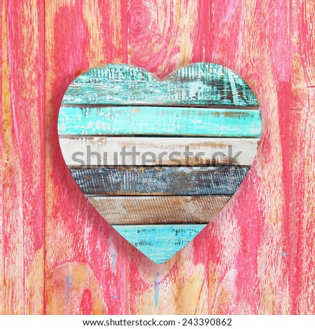 wooden heart on vintage background - stock photo