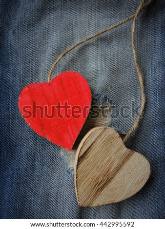 Wooden hearts on jeans background - stock photo