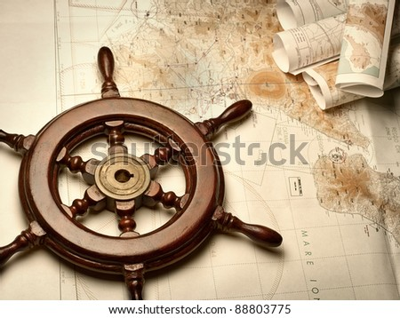 wooden helm on the navigation map,for navigation,travel,adventure themes - stock photo