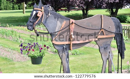 Wooden horse in the park - stock photo