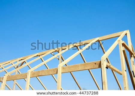 Wooden hothouse against the blue sky
