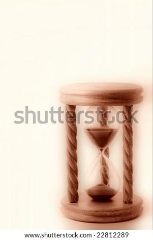 Wooden hourglass - stock photo