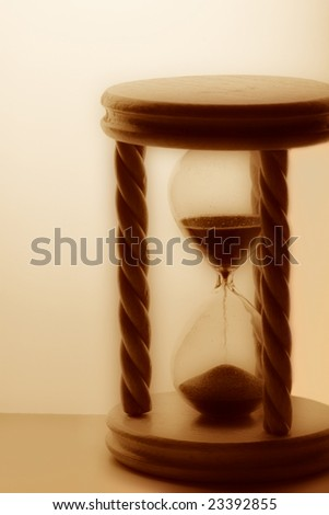 Wooden hourglass sepia toned - stock photo
