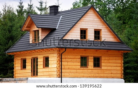Wooden house during construction, architecture and technology - stock photo