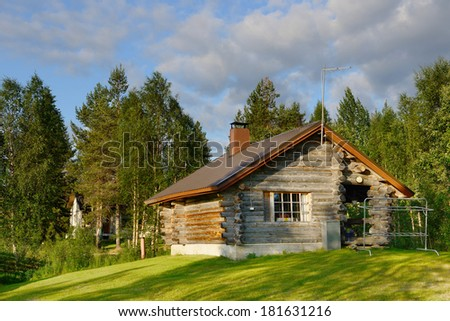 Wooden house in forest - stock photo