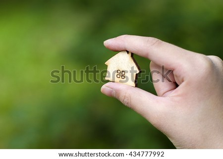 wooden house in the children's arm