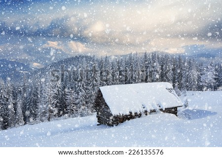 Wooden house in the mountains. Christmas scenery and fresh snow. Cloudy day. Carpathian mountains, Ukraine, Europe - stock photo