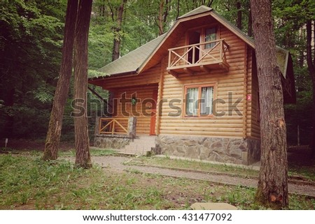 wooden house in the woods - stock photo