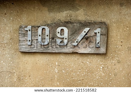 wooden house number - stock photo