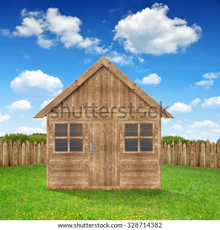 Wooden house on meadow