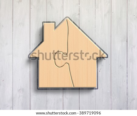 Wooden house shape puzzles, on wood wall background.