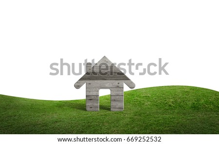 Wooden house symbol stand on green grass field area isolated on white background with clipping path.