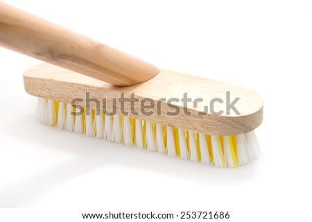 Wooden household brush isolated on white background - stock photo