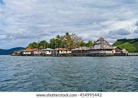 Wooden houses on piles on lake Sentani, on New Guinea Island, Indonesia. - stock photo