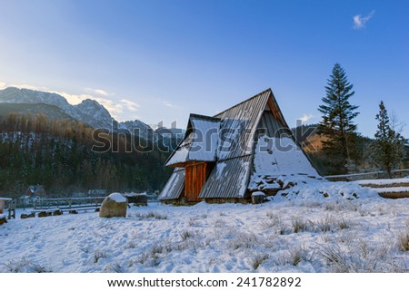 Wooden hut in Tatra mountains at night, Poland - stock photo