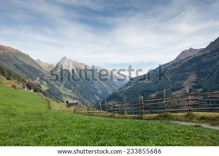 wooden hut in the tyrolean alps - stock photo