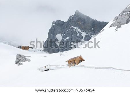 Wooden hut on Jade Dragon snow mountain Lijiang city, Yunnan China - stock photo