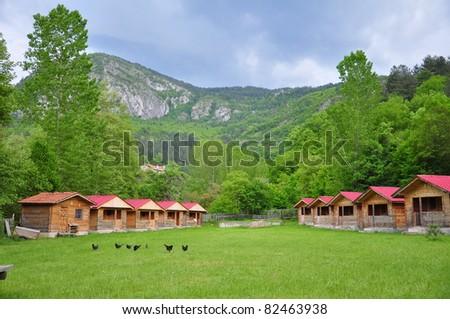 wooden huts at nature - stock photo