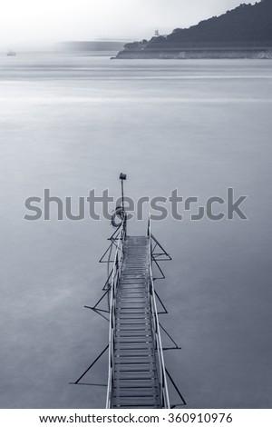 wooden jetty at dusk - stock photo