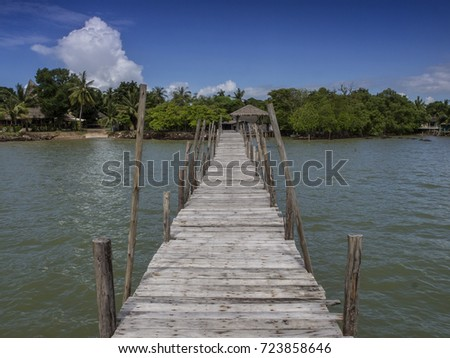 Wooden jetty leading to the ocean at Laem Ngop, That, east Thailand. Launches speedboats to Ko Kit island.