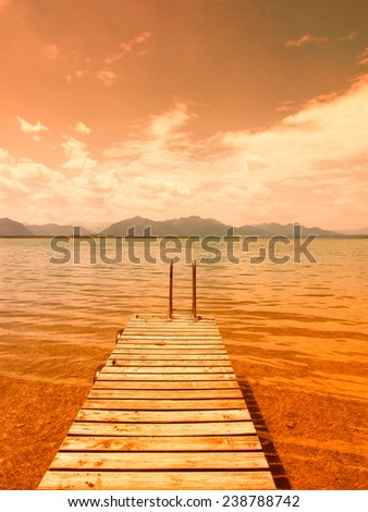 wooden jetty on lake chiemsee  - stock photo