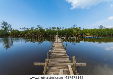 Wooden Jetty to paradise - stock photo