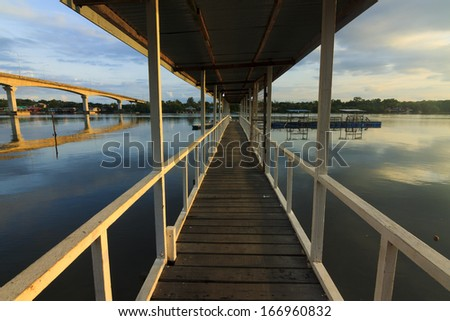Wooden jetty with beautiful morning lights - stock photo
