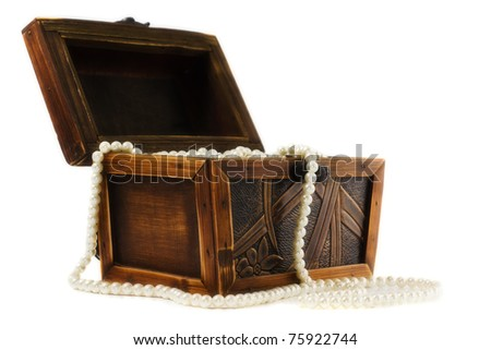 Wooden jewellery box packed with necklace and beads
