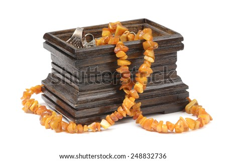 Wooden jewelry box on a white background - stock photo
