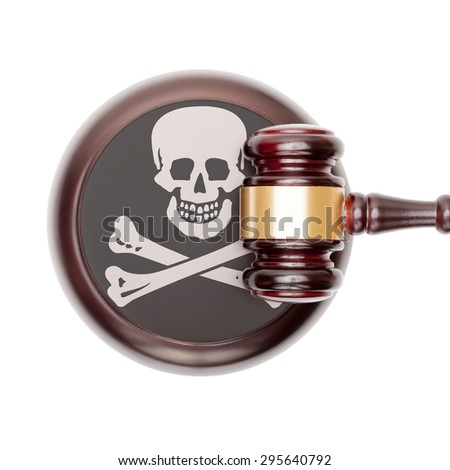 Wooden judge gavel with flag on sound block - Jolly Roger - stock photo