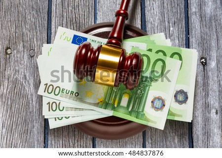 Wooden judge's gavel and one hundred euro banknotes