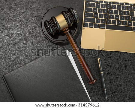 Wooden judges gavel and laptop computer on black leather desk. High resolution - stock photo