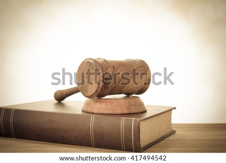 Wooden judges gavel on desk with law books. retro style. Concept of legal education. - stock photo