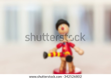 wooden kid in room for children, blur background  - stock photo