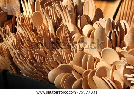 Wooden kitchen tools on sale in an Italian market - stock photo