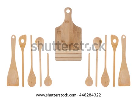 Wooden kitchen utensils and crockery for cooking - spoons, stirrers, blades and cutting Board