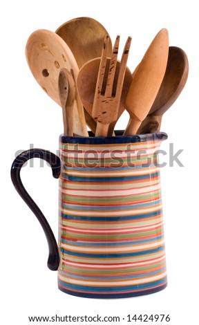 wooden kitchen utensils in a jug - stock photo