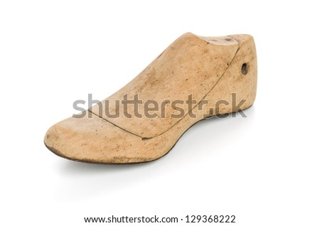 wooden last for a kids shoe - stock photo