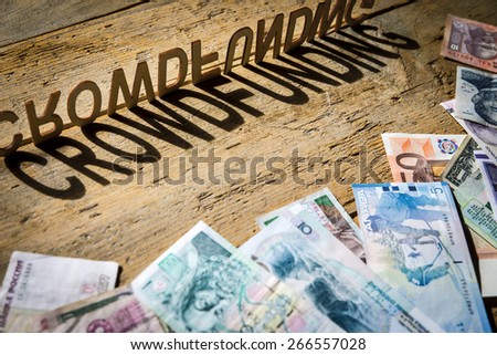 wooden letters on old aged wooden table build the shadow word crowdfunding, vintage style